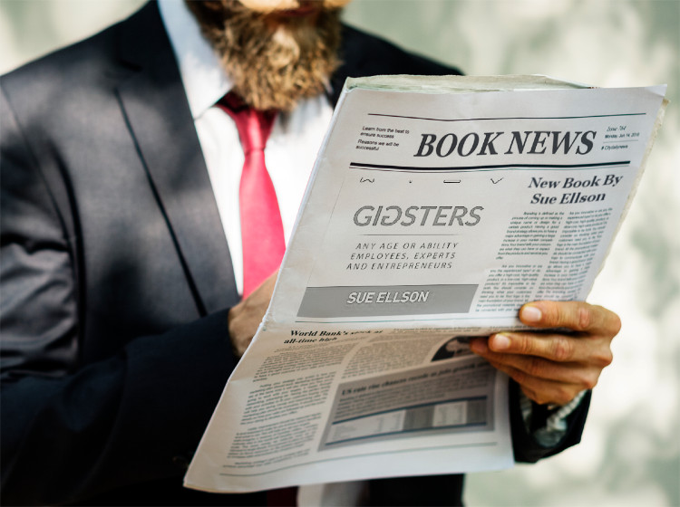 Man reading newspaper with article on Gigsters