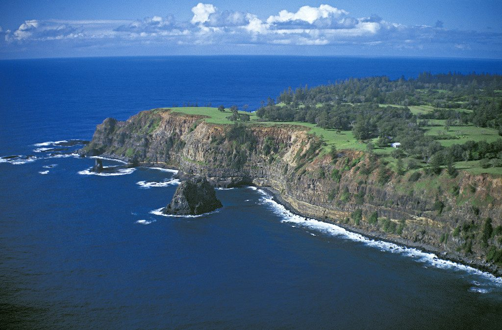 coastline of norfolk island, green land with deep blue ocean