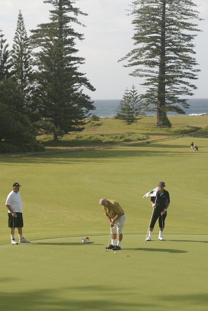 men playing golf on green at norfolk island