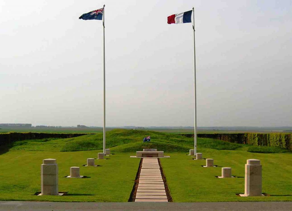 Australian and French flags on two poles in a green gold with concrete posts leading to the flagpoles. This is Barry Gracey's Retirement Project