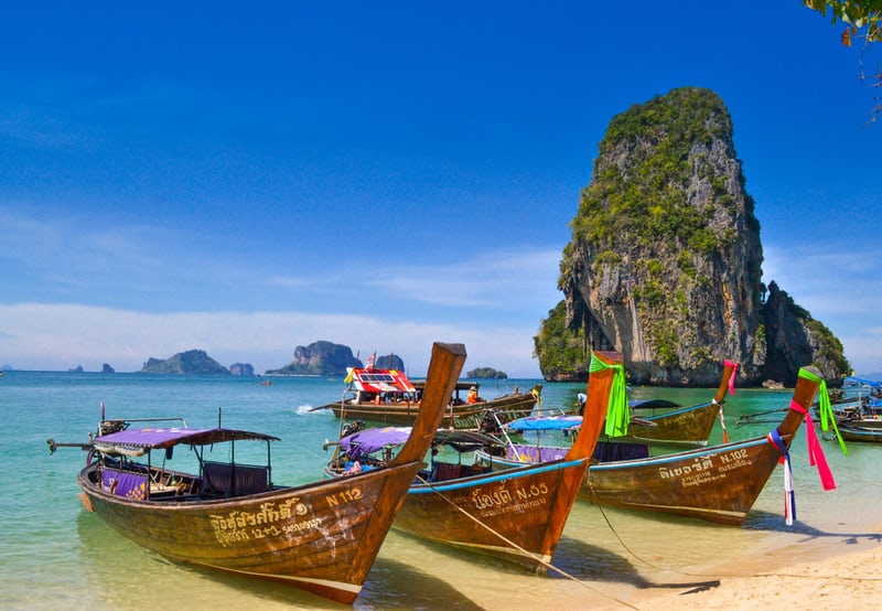 Brightly coloured small boats on a Thailand beach