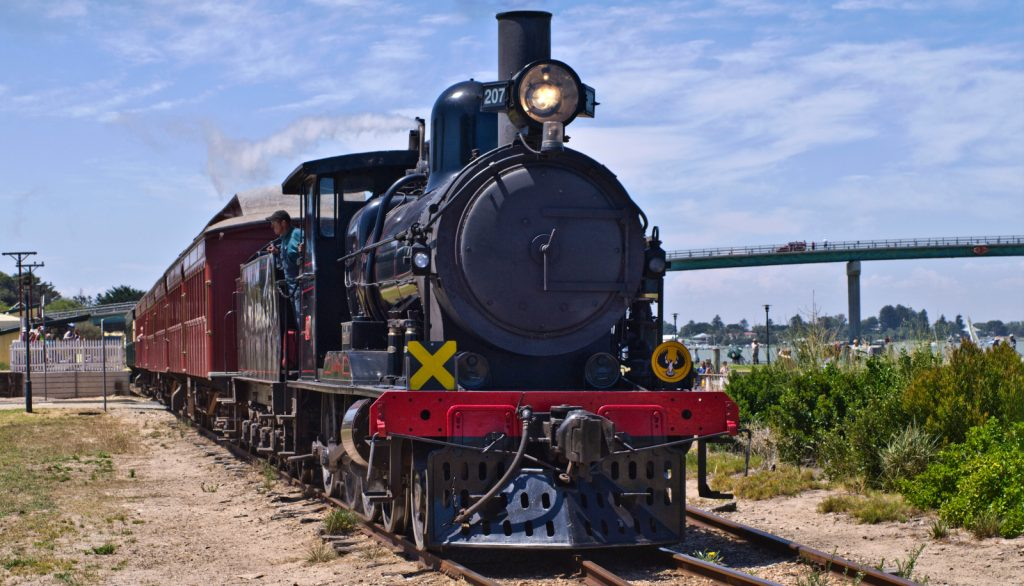 Red and black steam train at Goolwa station Statistics & Where To Retire In Australia