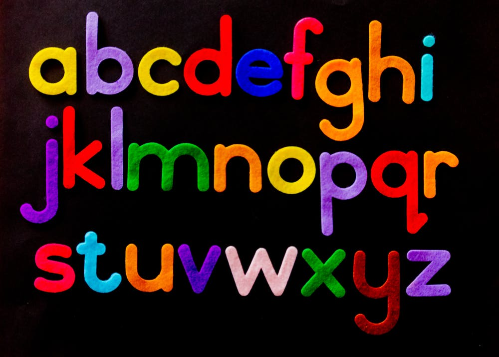 Brightly coloured alphabet on black background