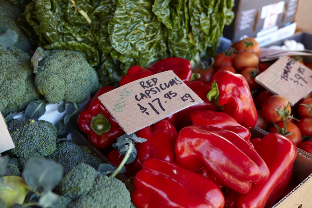 Broccoli, Red Capsicum, Tomatoes and Silver Beet at a market stall.